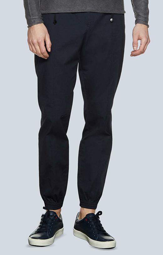 Dopasowane spodnie bawełniane z drukowanym, drobnym wzorem